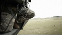 Black Hawk helicopter delivering cargo.