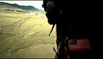 Soldier looking out of helicopter