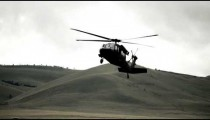 Black Hawk helicopter turning in to land