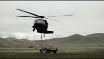 Helicopter landing Humvee