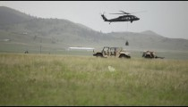 Helicopter dropping cargo in field