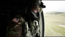 Soldier gazing out of helicopter door
