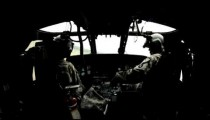 Wide angle shot from in Black Hawk helicopter of the pilots.