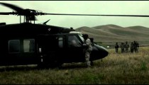 Black Hawk helicopter and soldier in field.
