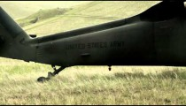 Shot from field of landed Black Hawk helicopter tail boom.