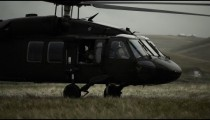 Shot from field of Black Hawk taking off.