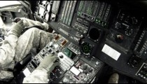 Black Hawk copilot looking at and adjusting instruments.