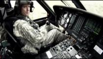Black Hawk copilot landing and checking door.