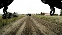 Shot from under vehicle in convoy training; in muddy road.