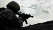 Static shot of soldier shooting automatic rifle.