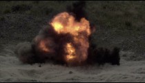 Fiery explosion in slow motion at blasting area.
