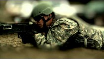 Center focused only super slow motion shot of soldier shooting chain gun