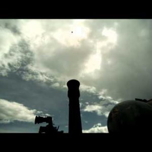 Slow motion shot from behind of soldiers firing mortar, mortar remaining visible.