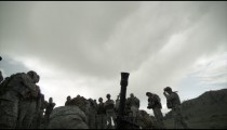 Slow motion shot of soldiers after mortar fire.