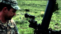 Slow motion shot of soldier setting up mortar launcher and instructor inspecting.