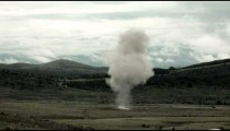Large explosion with visible shockwave, and smoke drifting off.