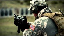 Soldier with ear protection shoots an MP5 in short bursts