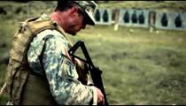Soldier shoots a Sterling Submachine Gun
