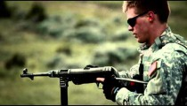 Young soldier shooting an MP40