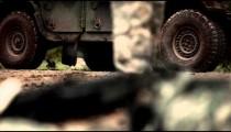 Ground level shot of a machine gun, near a military jeep.