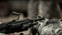 Close-up tracking shot of machine guns