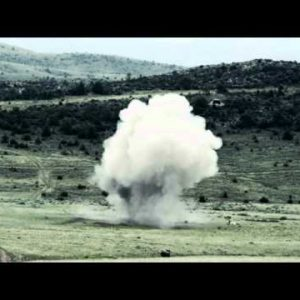 Slow motion explosion and shockwave at Green Beret training.