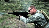 Soldier shooting automatic carbine.