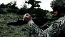 Soldier in helmet shooting an MP5