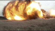 View from the ground as a massive explosion flips the camera around.