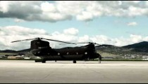 Time-lapse of soldiers working on a Chinook helicopter.