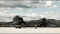 Time lapsed, CH-47 Chinook Helicopter at an airfield.