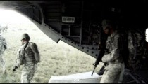 CH-47 Chinook helicopter as it lands, the ramp lowers, and soldiers move out.