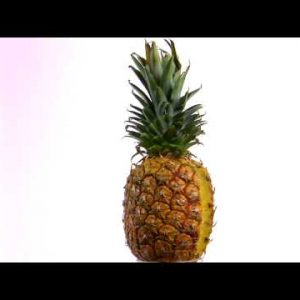 Pineapple rotating on a white screen.