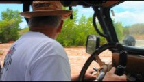 Older man driving jeep