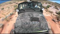 Jeep driving through mud in Moab
