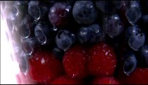 Tilt down shot of an assortment of fruit in a vase.