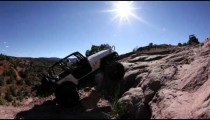 Jeeps Attempts to Scale Large Rock