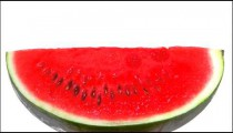 Watermelon rotating on a white screen.