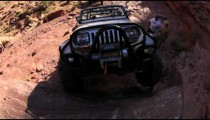 Jeep Attempts to Climb an Almost Vertical Rock Face