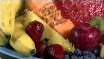 Assortment of fruit on a rotating plate.