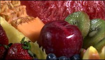 Assortment of fruit rotating on a plate.