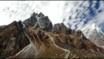Time-lapse of the rocky Himalayan Taboche and Cholatse peaks with passing clouds and moon.