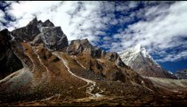 Time-lapse of the rocky Himalayan Taboche and Cholatse peaks with passing clouds.