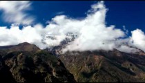 Time-lapse of clouds moving around Himalayan Khatang and Karyolung mountains.