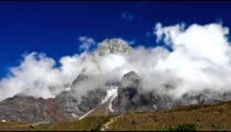 Time-lapse of clouds swirling around sacred Khumjung Himalayan peak.