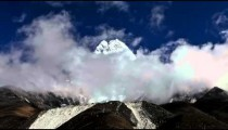 Time-lapse of clouds passing in front of Ama Dablam, a Himalayan peak.