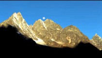 Time-lapse of the moon going behind Himalayan peaks in the morning in Nepal.