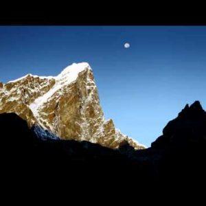 Sunrise time-lapse of the moon setting behind Taboche peak.