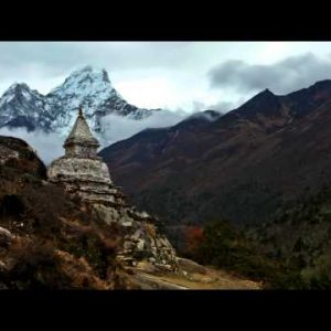 Time-lapse of a buddhist stupa with Ama Dablam peak in the background.