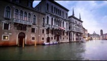 Tracking shot of dark buildings on the Grand Canal